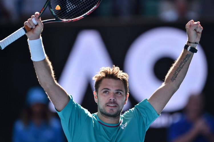 Stan Wawrinka comemora após avançar às semifinais do Aberto da Austrália (Peter Parks/AFP)
